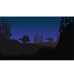 Stegosaurus in fields scenery at night vector