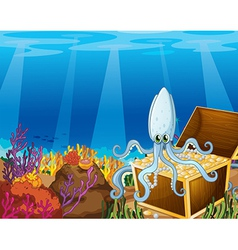 A treasure box under the sea with an octopus vector