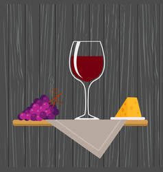 glass of red wine with grapes and cheese vector image