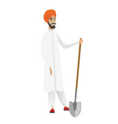 Young hindu farmer holding a shovel vector