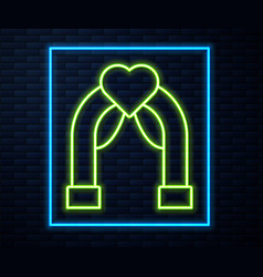 Glowing neon line wedding arch icon isolated on vector