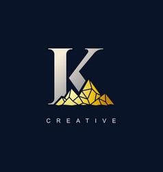 letter k with golden mountain logo vector image
