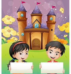 Two kids with empty signages standing in front of vector image