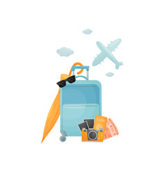 Modern blue closed suitcase on wheels vector