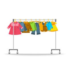 kids clothes hanging on hanger rack vector image