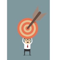 Businessman holding target with arrow vector image