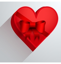 Gift box with red ribbon in the form of heart vector