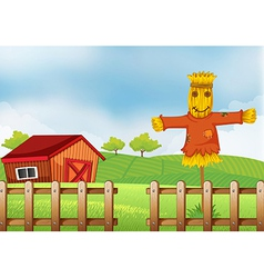 A scarecrow inside the wooden fence vector