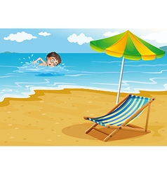 A boy swimming at the beach with an umbrella and a vector image