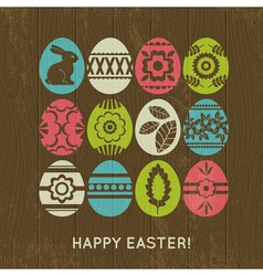 wooden background with color easter eggs vector image vector image