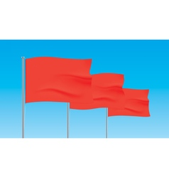 Red flags waving on a blue sky background vector