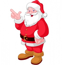 Christmas Santa pointing vector image vector image