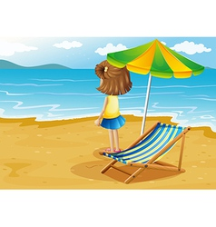 A girl at the beach with a foldable chair and an vector image vector image