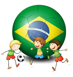 Boys playing soccer with the flag of Brazil vector