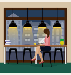 woman working at the computer at the bar counter vector image