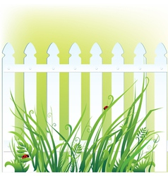 A fragment of white fence and grass vector