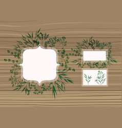 Set of frame with laurel leafs wooden background vector