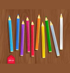 color pencils on wooden desk background vector image