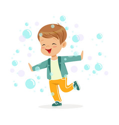 cute happy little boy playing bubbles vector image