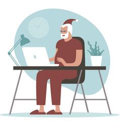 Santa claus using laptop at home vector