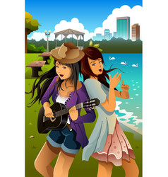 Teenage girls singing and playing guitar together vector