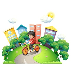 A boy biking at the road going to the high vector image