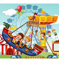 Children riding on rides at the funfair vector image