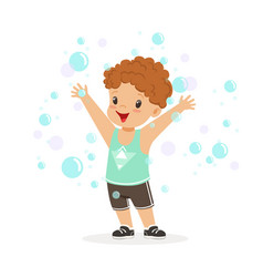 happy redhead boy playing bubbles vector image