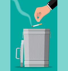 hand putting cigarettes in trash bin vector image