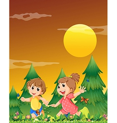 Two kids playing at the garden with the vector image