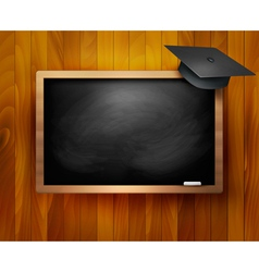 Blackboard with graduation cap vector image vector image