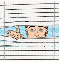Pop art surprised man looking through blinds vector