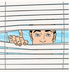 Pop art surprised man looking through the blinds vector