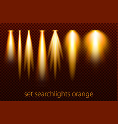 set of orange searchlights on a transparent vector image