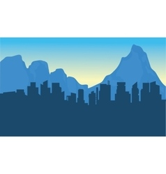 Silhouettte of city and background mountain vector