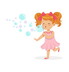 happy redhead girl in pink dress blowing bubbles vector image