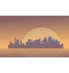 Silhouette of buildings and big moon vector image
