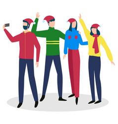 people taking selfie wearing santa hats vector image