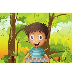 A boy holding an empty eggtray in the forest vector image vector image
