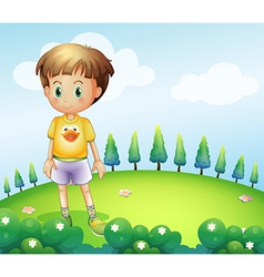 A kid standing at the hilltop vector