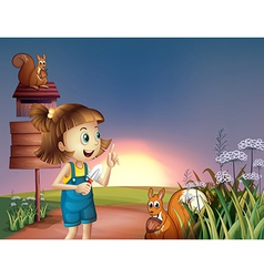 A girl with a shovel standing near the wooden vector
