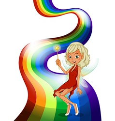 A smiling fairy above the rainbow vector image