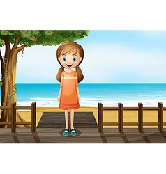 A smiling young girl standing at the wooden bridge vector