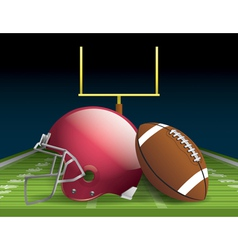 American football and helmet on field vector