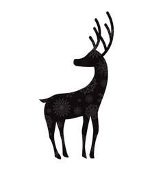 Black silhouette of reindeer with snow flakes vector