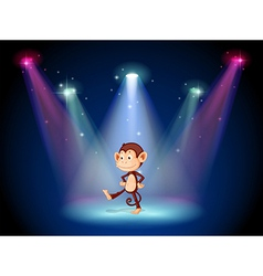 A monkey dancing on the stage with spotlights vector
