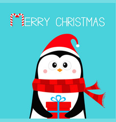 merry christmas penguin holding gift box present vector image