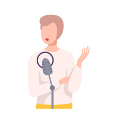 young man with microphone talking or singing in vector image