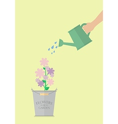 Hand watering flower in pot vector image