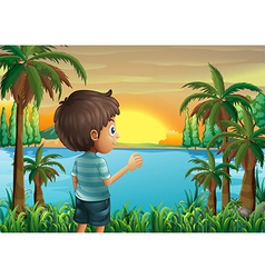 A boy watching the sunset at the riverbank vector